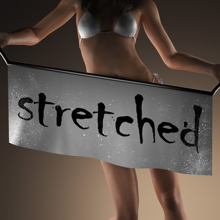 stretched: stretched word on banner and bikiny woman
