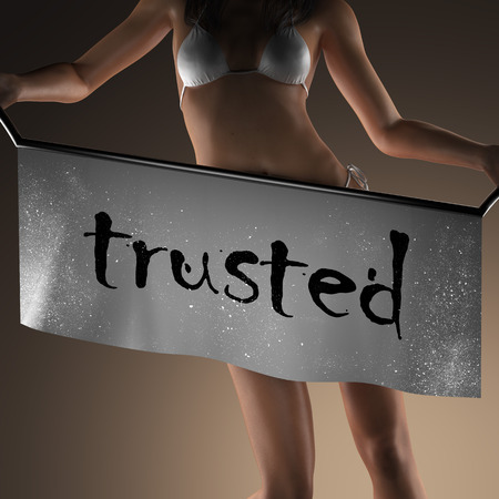 trusted: trusted word on banner and bikiny woman Stock Photo