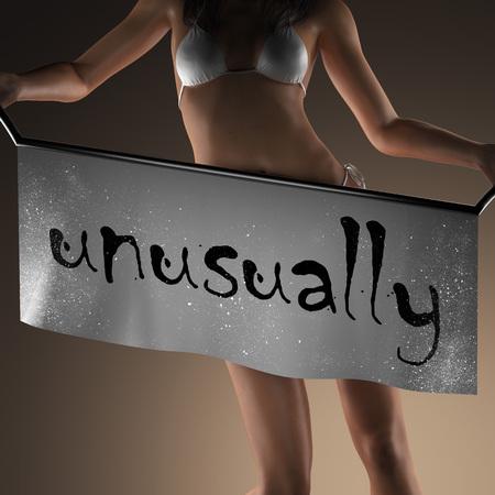 unusually: unusually word on banner and bikiny woman