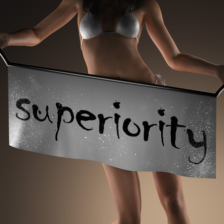 superiority: superiority word on banner and bikiny woman Stock Photo