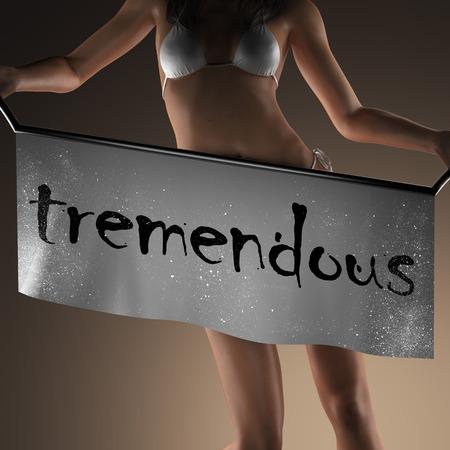 tremendous: tremendous word on banner and bikiny woman Stock Photo