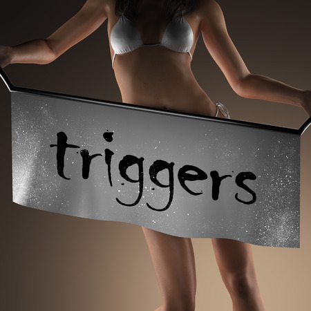 triggers: triggers word on banner and bikiny woman