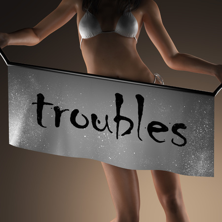 troubles: troubles word on banner and bikiny woman