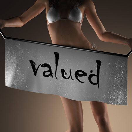 valued: valued word on banner and bikiny woman