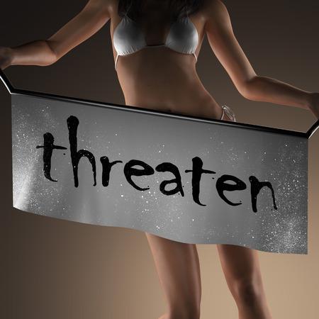 threaten: threaten word on banner and bikiny woman