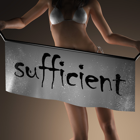 sufficient: sufficient word on banner and bikiny woman Stock Photo