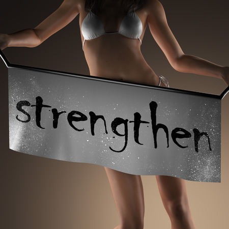 strengthen: strengthen word on banner and bikiny woman Stock Photo