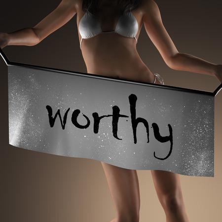 worthy: worthy word on banner and bikiny woman