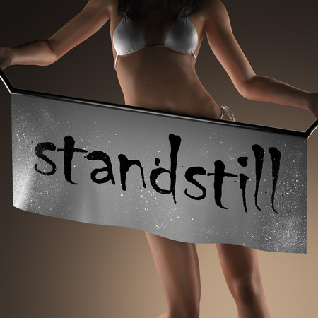 standstill: standstill word on banner and bikiny woman