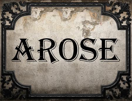 arose: arose word on concrette wall