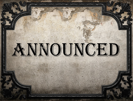 announced: announced word on concrette wall Stock Photo