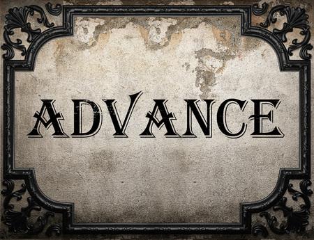 advance: advance word on concrette wall Stock Photo
