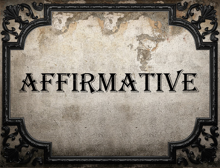 affirmative: affirmative word on concrette wall Stock Photo