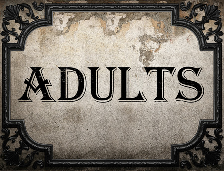 adults: adults word on concrette wall