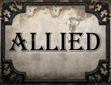 allied: allied word on concrette wall
