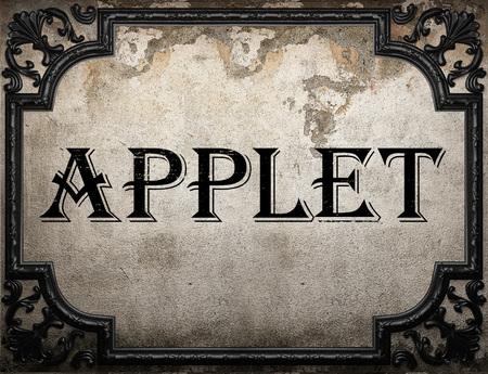 applet: applet word on concrette wall