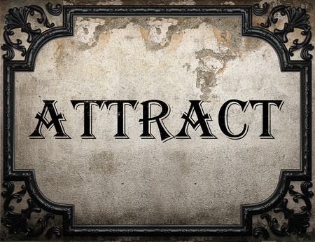 attract: attract word on concrette wall Stock Photo