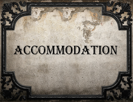 accommodation: accommodation word on concrette wall