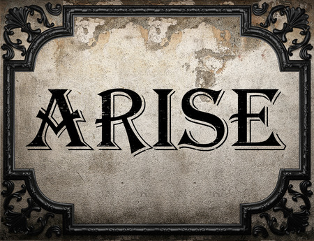 arise: arise word on concrette wall