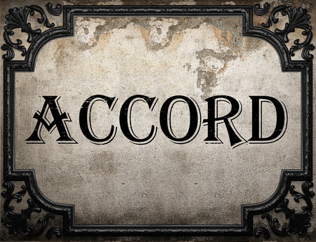 accord: accord word on concrette wall