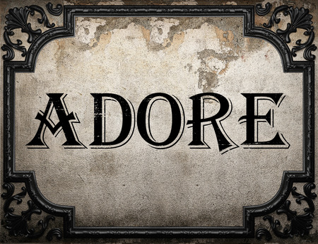 adore: adore word on concrette wall Stock Photo