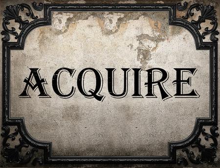 acquire: acquire word on concrette wall