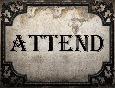 to attend: attend word on concrette wall Stock Photo