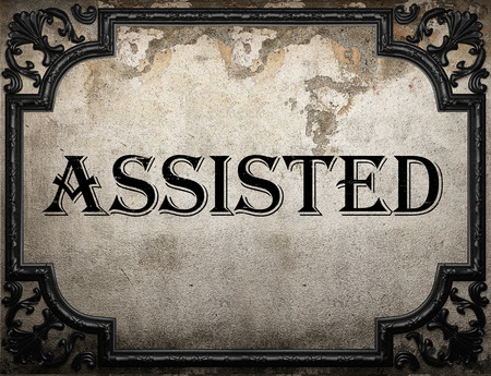 assisted: assisted word on concrette wall