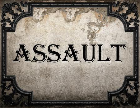 assault: assault word on concrette wall