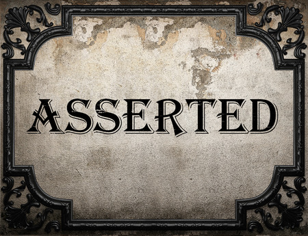 asserted: asserted word on concrette wall