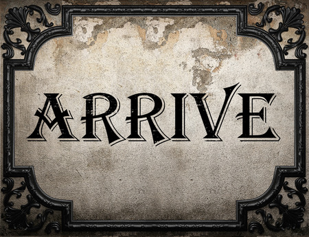 arrive: arrive word on concrette wall Stock Photo