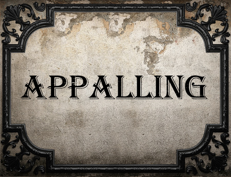 appalling: appalling word on concrette wall