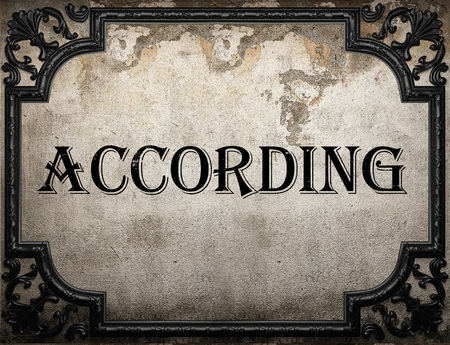 according: according word on concrette wall Stock Photo