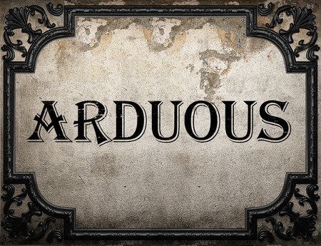 arduous: arduous word on concrette wall