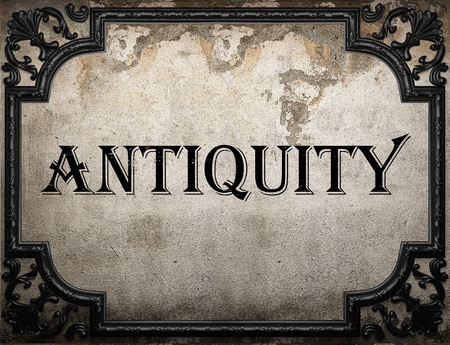 antiquity: antiquity word on concrette wall