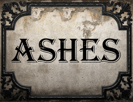 the ashes: ashes word on concrette wall