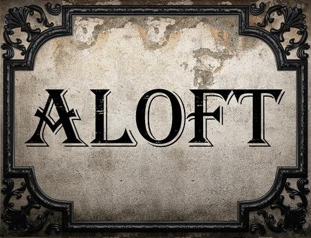 aloft: aloft word on concrette wall