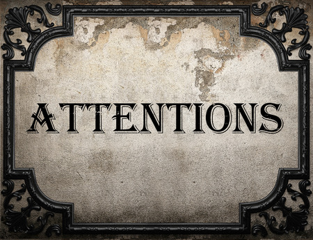 attentions: attentions word on concrette wall Stock Photo