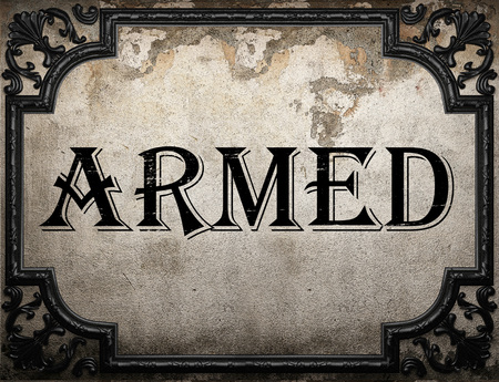 armed: armed word on concrette wall Stock Photo