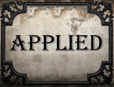 applied: applied word on concrette wall