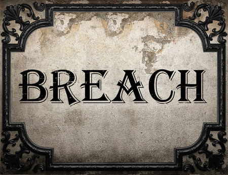 breach: breach word on concrette wall Stock Photo