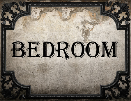 bedroom wall: bedroom word on concrette wall Stock Photo