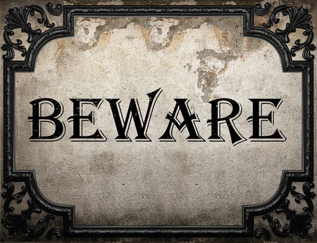 beware word on concrette wall Stock Photo