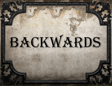 backwards: backwards word on concrette wall Stock Photo
