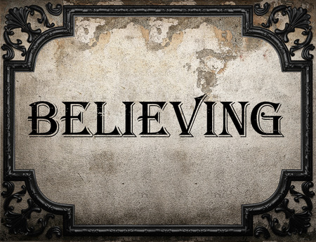 believing: believing word on concrette wall