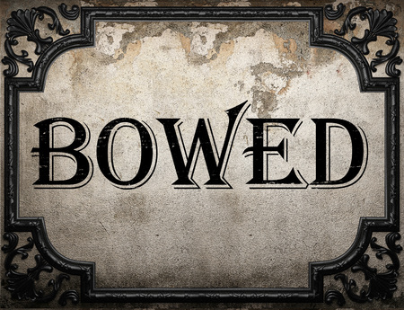 bowed: bowed word on concrette wall
