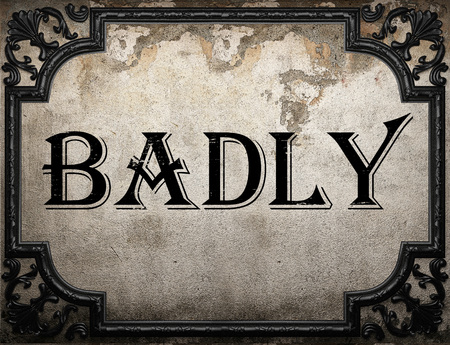 badly: badly word on concrette wall Stock Photo
