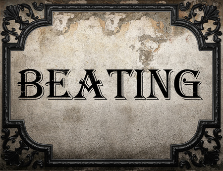 beating: beating word on concrette wall