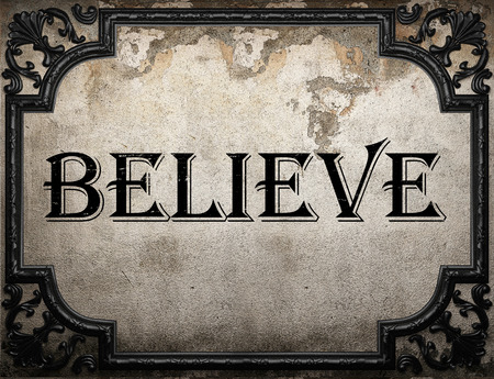 believe: believe word on concrette wall