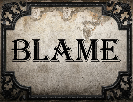 blame: blame word on concrette wall Stock Photo